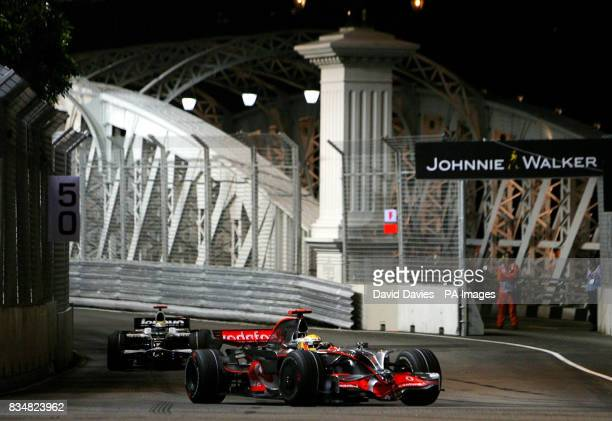 McLaren Mercedes' Lewis Hamilton drives over the Anderson Bridge during a practice session at the Marina Bay Circuit Park in Singapore