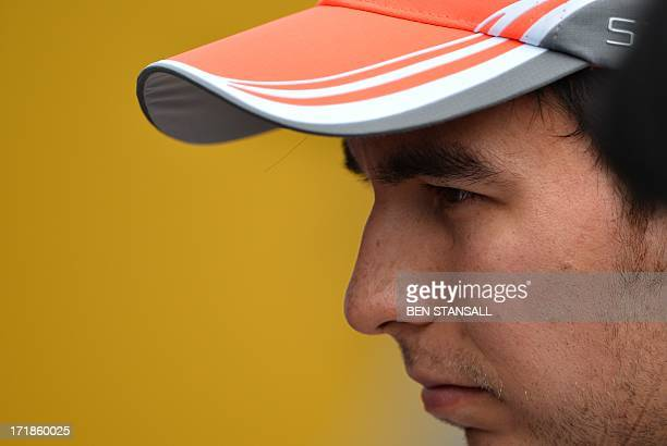McLaren Mercedes' Mexican driver Sergio Perez walks after the qualifying session at the Silverstone circuit in Silverstone on June 29, 2013 ahead of...
