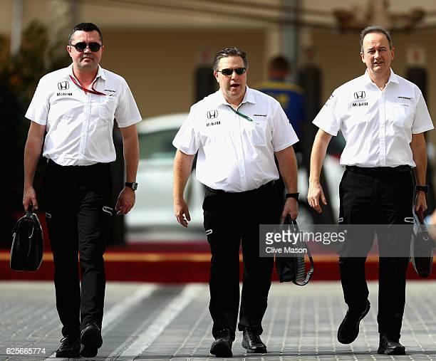 McLaren Racing Director Eric Boullier McLaren Executive Director Zak Brown and Jonathan Neale Chief Operating Officer of McLaren walk in the Paddock...