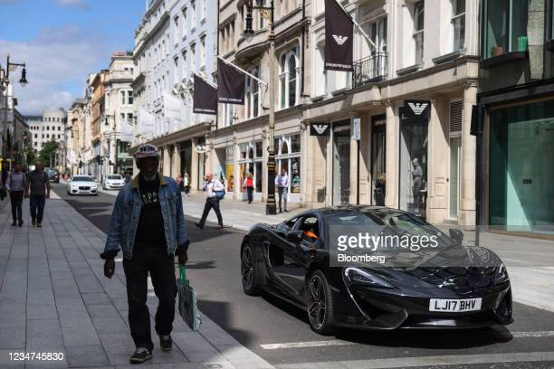 McLaren supercar drives down New Bond Street in London, U.K., on Wednesday, Aug. 18, 2021. U.K. Inflation eased in July in what is widely seen as a...
