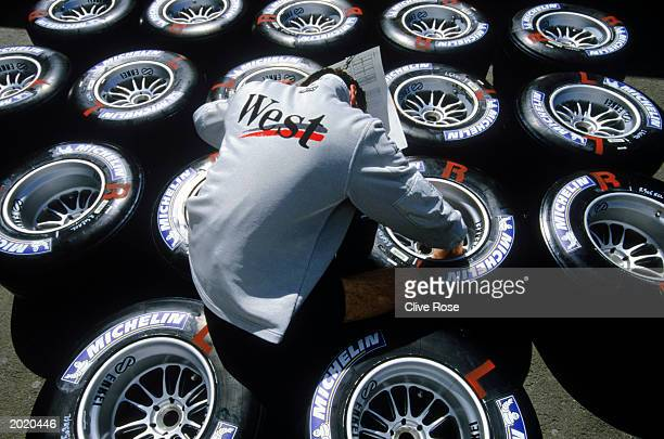 McLaren technician inspects the Michelin tyres during the Austrian Formula One Grand Prix held on May 18, 2003 at the A1 Ring, in Spielberg, Austria.