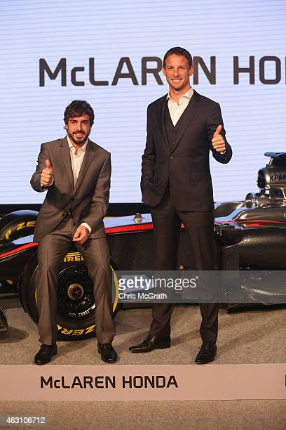 McLaren-Honda drivers Fernando Alonso and Jenson Button pose for photographs during a press conference at the Honda Motor Co. Headquarters on...