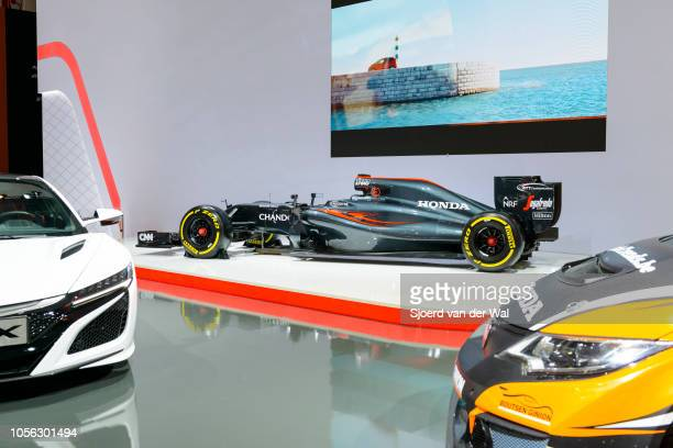 McLarenHonda MP431 2016 Formula 1 Grand Prix race car and Honda NSX and Honda Civic Type R on display at Brussels Expo on January 13 2017 in Brussels...