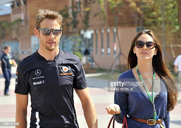 McLarenMercedes driver Jenson Button of Britain and his girlfriend Jessica Michibata arrive at the paddock ahead of the Formula One Korean Grand Prix...