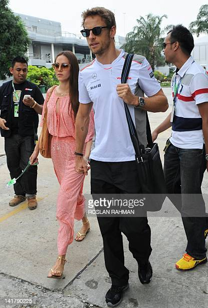 McLarenMercedes driver Jenson Button of Britain arrives with his girlfriend Jessica Michibata for the third practice session of Formula One Malaysian...