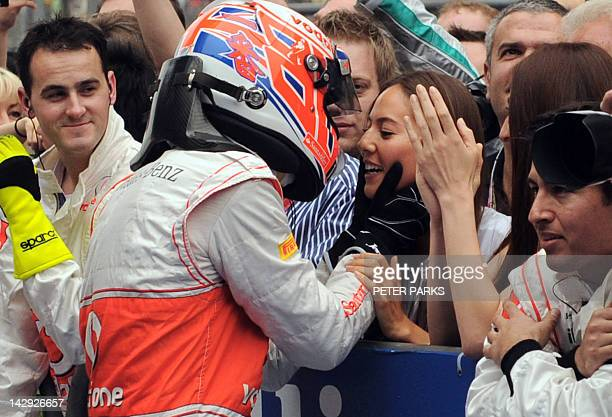 McLarenMercedes driver Jenson Button of Britain embraces his girlfriend Jessica Michibata after the finish of the Formula One Chinese Grand Prix at...