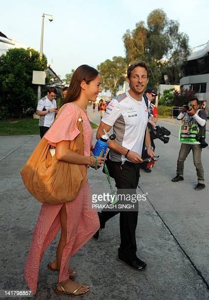 McLarenMercedes driver Jenson Button of Britain leaves with his girlfriend Jessica Michibata after the qualifying round of Formula One's Malaysian...