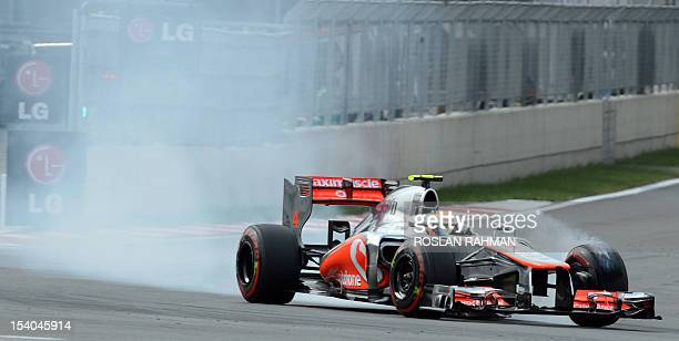 McLarenMercedes driver Lewis Hamilton of Britain burns rubber on a corner as he finished second in the qualifying session of the Formula One Korean...