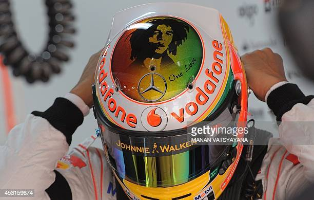McLarenMercedes driver Lewis Hamilton of Britain wears a helmet adorned with a portrait of late Jamaican reggae musician Bob Marley during the second...