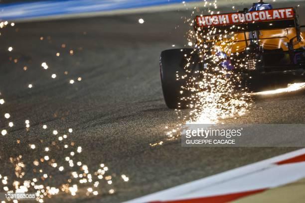 McLaren's Australian driver Daniel Ricciardo drives during the qualifying session on the eve of the Bahrain Formula One Grand Prix at the Bahrain...
