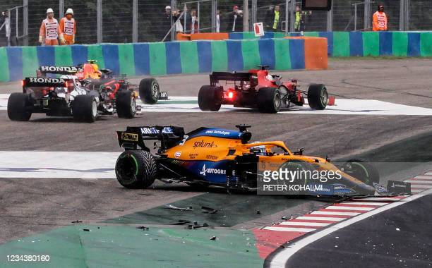 McLaren's Australian driver Daniel Ricciardo stands on the side of the track after his car was involved in a crash at the start of the Formula One...