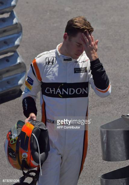 McLaren's Belgian driver Stoffel Vandoorne abandons the Brazilian Formula One Grand Prix at the Interlagos circuit in Sao Paulo Brazil on November 12...