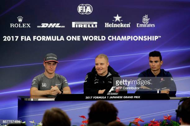 McLaren's Belgian driver Stoffel Vandoorne Mercedes' Finnish driver Valtteri Bottas and Sauber's German driver Pascal Wehrlein attend a press...