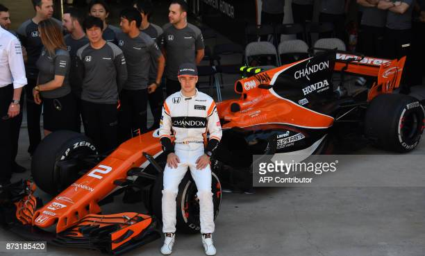 McLaren's Belgian driver Stoffel Vandoorne poses for pictures in the pits before the Brazilian Formula One Grand Prix at the Interlagos circuit in...