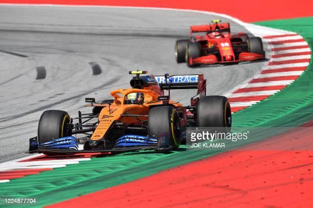 McLaren's British driver Lando Norris steers his car in front of Ferrari's Monegasque driver Charles Leclerc during the Austrian Formula One Grand...