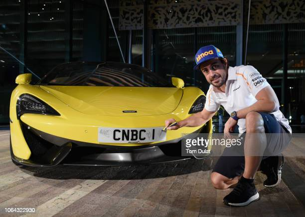 McLaren's Fernando Alonso attends CNBC's launch party with Hadley Gamble prior to the Abu Dhabi Grand Prix weekend on November 22 2018 in Abu Dhabi...