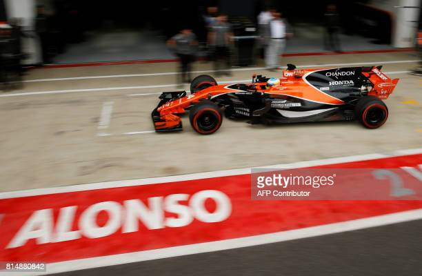 McLaren's Fernando Alonso stops in the pits during the qualifying session at the Silverstone motor racing circuit in Silverstone central England on...
