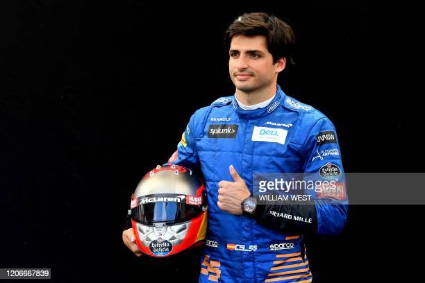 McLaren's Spanish driver Carlos Sainz Jr poses for a photo at the Albert Park circuit ahead of the Formula One Australian Grand Prix in Melbourne on...