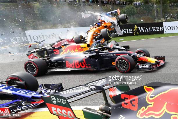 TOPSHOT McLaren's Spanish driver Fernando Alonso crashes during the Belgian Formula One Grand Prix at the SpaFrancorchamps circuit in Spa on August...