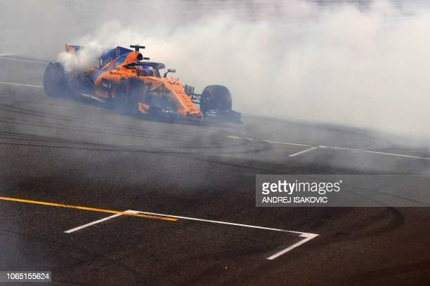 McLaren's Spanish driver Fernando Alonso drifts with his car after his last F1 race at the Abu Dhabi Formula One Grand Prix at the Yas Marina circuit...