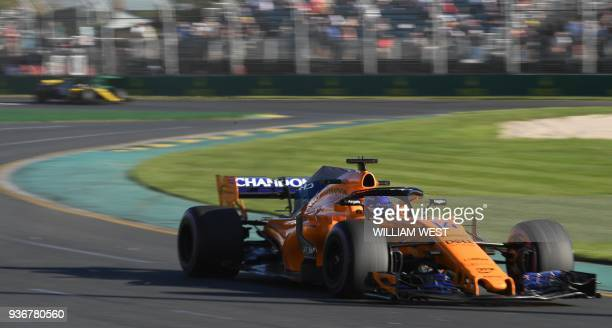 McLaren's Spanish driver Fernando Alonso drives around the Albert Park circuit during the second Formula One practice session in Melbourne on March...