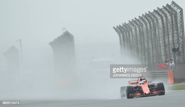 McLaren's Spanish driver Fernando Alonso drives during the first practice session of the Formula One Chinese Grand Prix in Shanghai on April 7 2017 /...