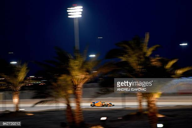 TOPSHOT McLaren's Spanish driver Fernando Alonso drives during the second practice session ahead of the qualifiers for the Bahrain Formula One Grand...