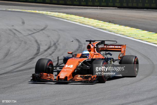 McLaren's Spanish driver Fernando Alonso powers his car during the Brazilian Formula One Grand Prix at the Interlagos circuit in Sao Paulo Brazil on...