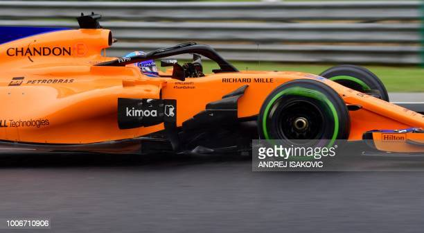 McLaren's Spanish driver Fernando Alonso steers his car during the qualifying session on the eve of the Formula One Hungarian Grand Prix at the...
