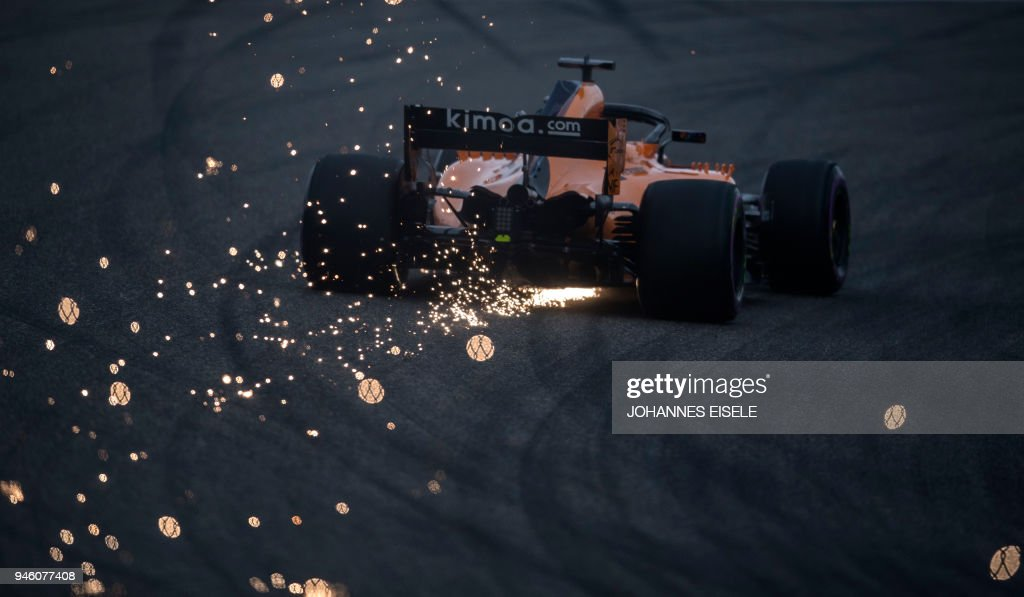 TOPSHOT - McLaren's Spanish driver Fernando Alonso steers his car during the qualifying session for the Formula One Chinese Grand Prix in Shanghai on April 14, 2018. / AFP PHOTO / Johannes EISELE