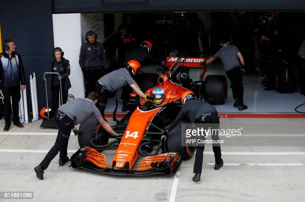 McLaren's Spanish driver Fernando Alonso stops in the pits during the qualifying session at the Silverstone motor racing circuit in Silverstone...