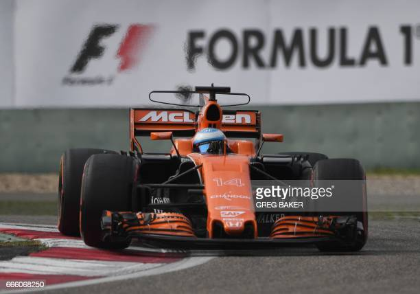 McLaren's Spanish driver Fernando Alonso takes a corner during the qualifying session for the Formula One Chinese Grand Prix in Shanghai on April 8...