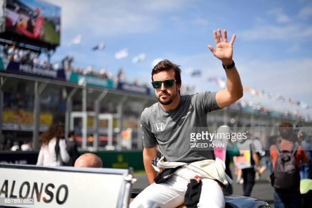 McLaren's Spanish driver Fernando Alonso takes part in the drivers parade prior to the start of the Formula One Australian Grand Prix in Melbourne on...
