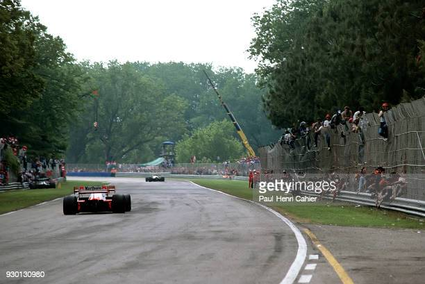 McLarenTag Porsche MP4/2 Grand Prix of San Marino Autodromo Dino Ferrari Imola 06 May 1984 Italian tifosi on the track as Alain Prost goes by