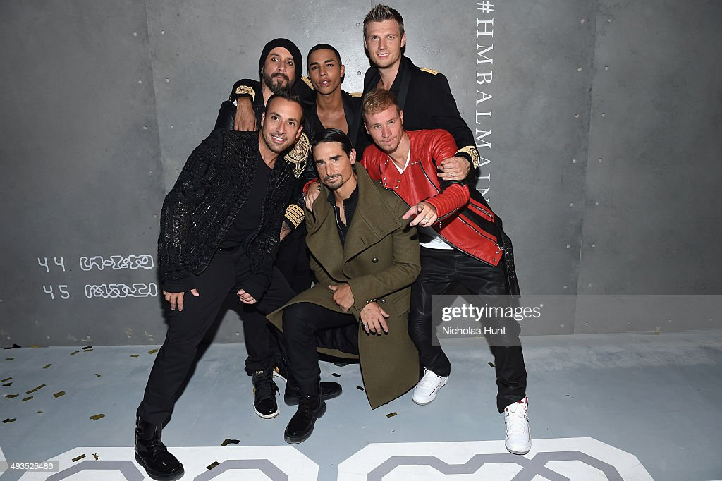 A. J. McLean, Howie Dorough, Kevin Richardson, Brian Littrell, and Nick Carter of the Backstreet Boys pose with Creative Director for Balmain Olivier Rousteing (C) at the BALMAIN X H&M Collection Launch at 23 Wall Street on October 20, 2015 in New York City.