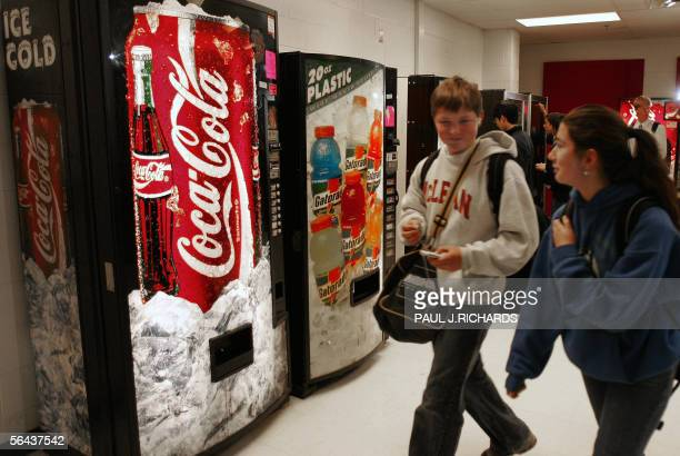 LAWYERS FATTEN UP OBESITY SUIT AGAINST 'BIG SODA' Students at McLean High School in McLean Virginia walk past vending machines on school property 15...