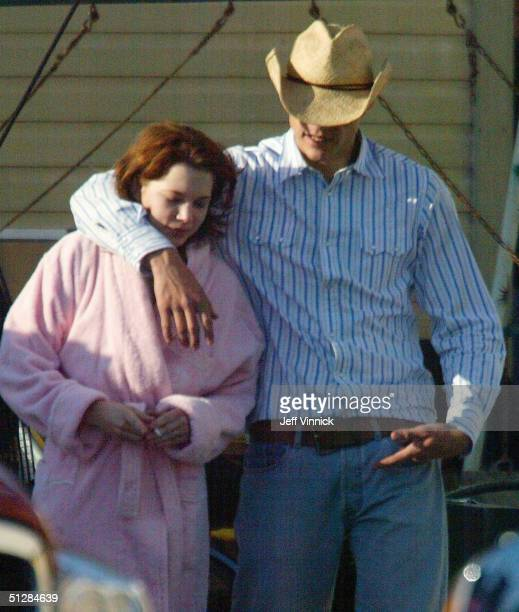 Actors Heath Ledger and Michelle Williams walk together while on a break during filming of Brokeback Mountain May 30 2004 in Fort McLoed Alberta