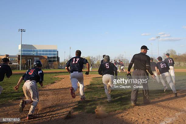McMahon Senators players celebrate victory in an extra inning 3-2 win during the High School Baseball ball game between Trumbull Golden Eagles and...