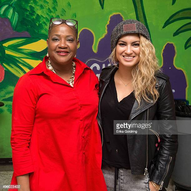 McMain Principal Bridgette B. Frick and singer-songwriter Tori Kelly gather for a photo during the GRAMMY Foundation Signature Schools grant...
