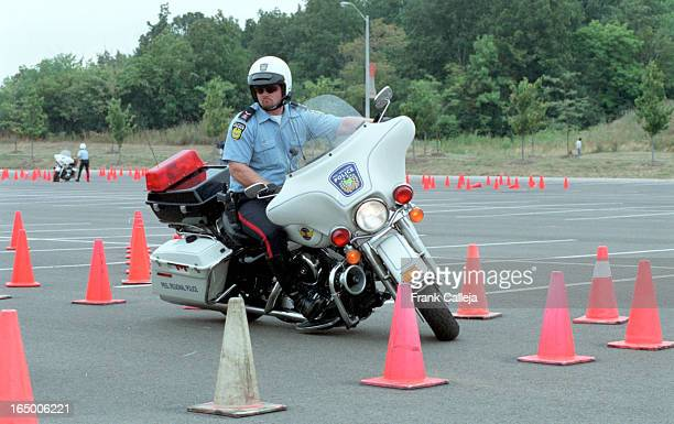 IAN POP VINCE ELGAR DAVE SERVICE AND CRAIG McMANUS general shots of various motorcycle officers practising precision cycle work using pilons This was...