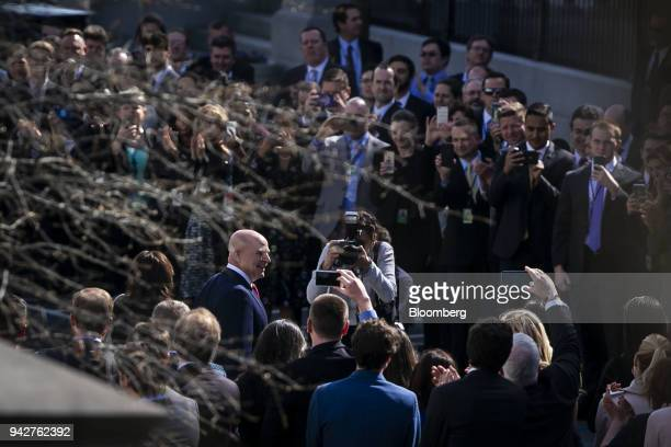 HR McMaster outgoing national security advisor center left is greeted with applause while departing on his last day of work at the White House in...