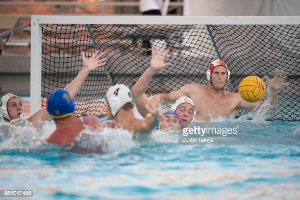 McQuin Baron of the University of Southern California attempts to block a shot during the Division I Men's Water Polo Championship held at the...