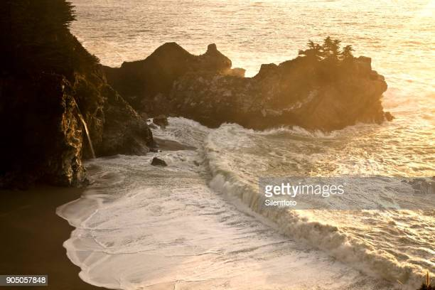 mcway falls & beach on central california coast - mcway falls stock pictures, royalty-free photos & images