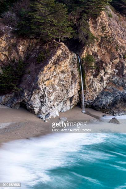 mcway falls pouring into pacific, big sur, california, usa - mcway falls stock pictures, royalty-free photos & images