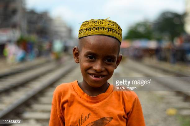 Md Ismail , a resident of the slum beside the Tejgaon rail line, he is a student of Madrasa, he plays over the rail line since they don't have a...