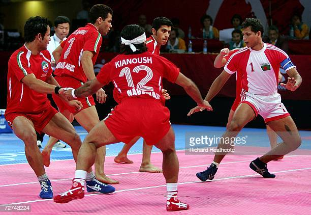 Md Ziaur Rahman of Bangladesh attempts a raid on the Islamic Republic of Iran during the Men's Kabaddi Bronze Medal match between the Islamic...