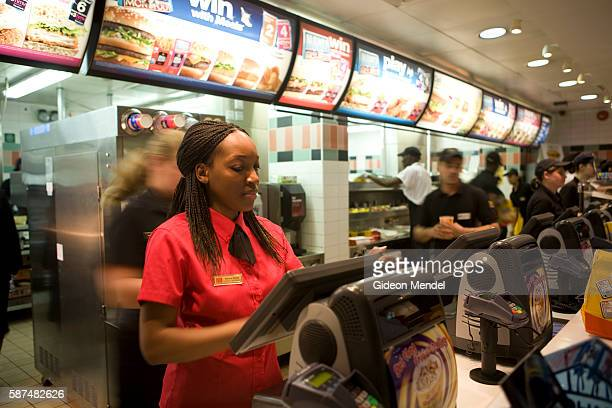 MdDonald's workers dressed in their new trendy coffee bar style ambience and design at the Cannon Street branch of McDonalds in the City of London...