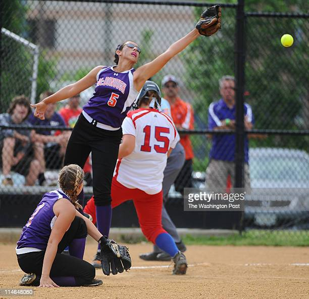 McDonough Lady Rams SS Erin Parlett leaps but can't haul in an errant throw in the 1st inning as Lansdowne scored 6 runs to start the game in the...