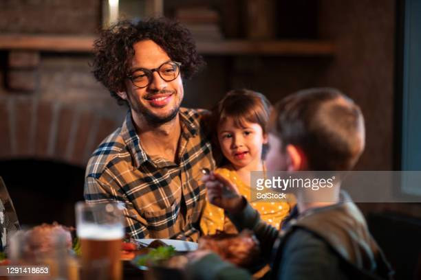 me and my children out for sunday lunch - son stock pictures, royalty-free photos & images