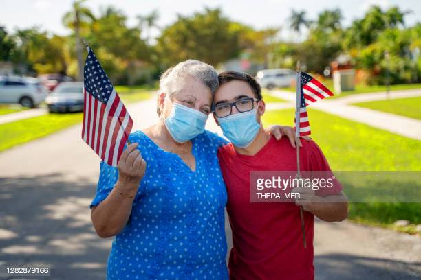 me and my grandson proud of our country and flag - republican party stock pictures, royalty-free photos & images